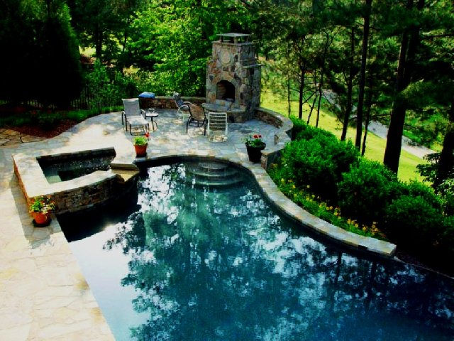 stone fireplace backyard pool